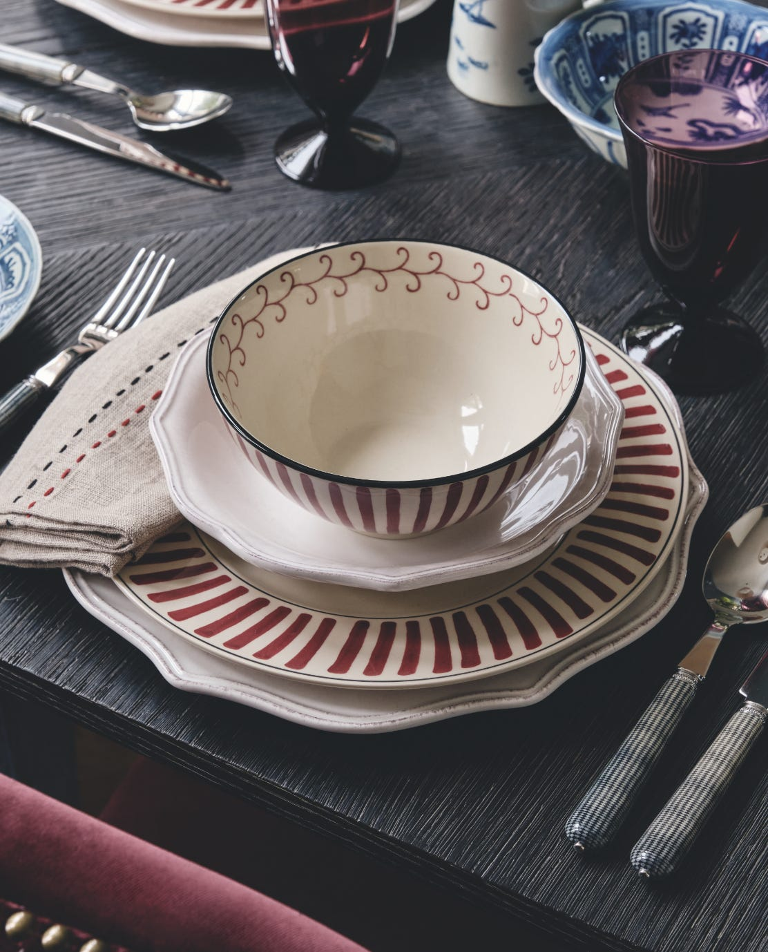 Striped Kintaro tableware on a dark wood table