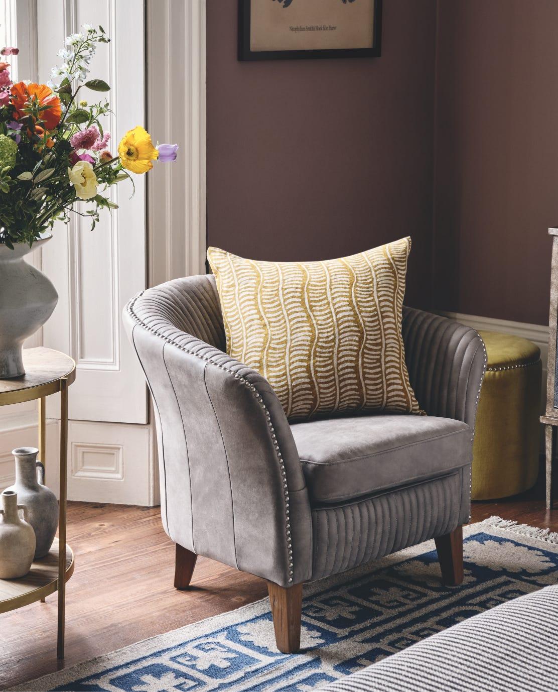 Ash Grey Crosby armchair with a yellow printed cushion