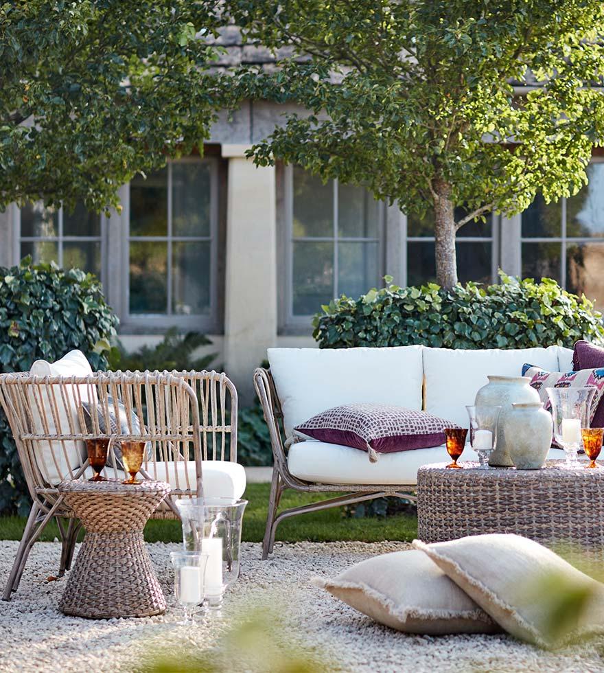 Rattan garden furniture beside a fire pit