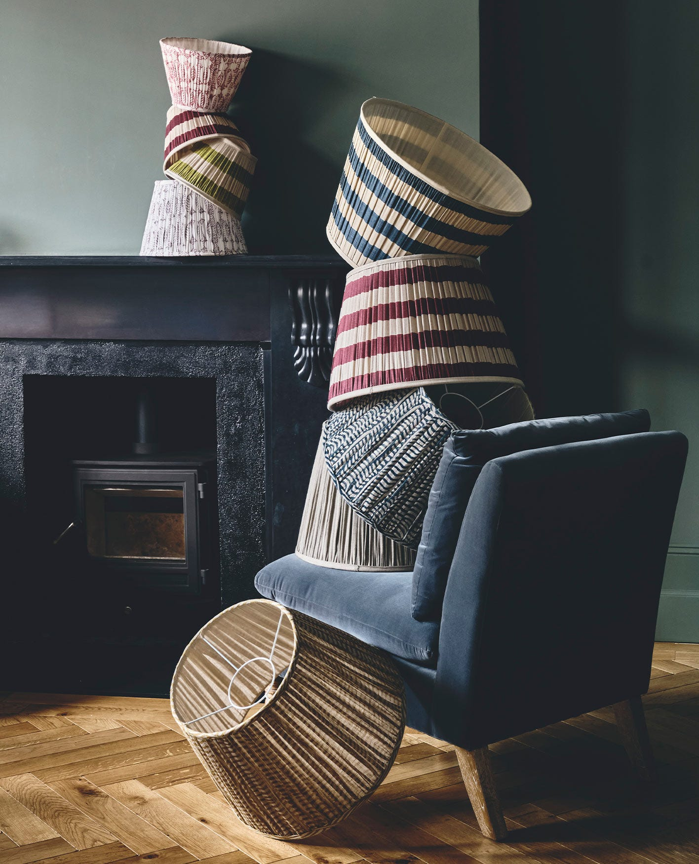 Cosy country cottage sitting room, full of comfortable seating and natural texture