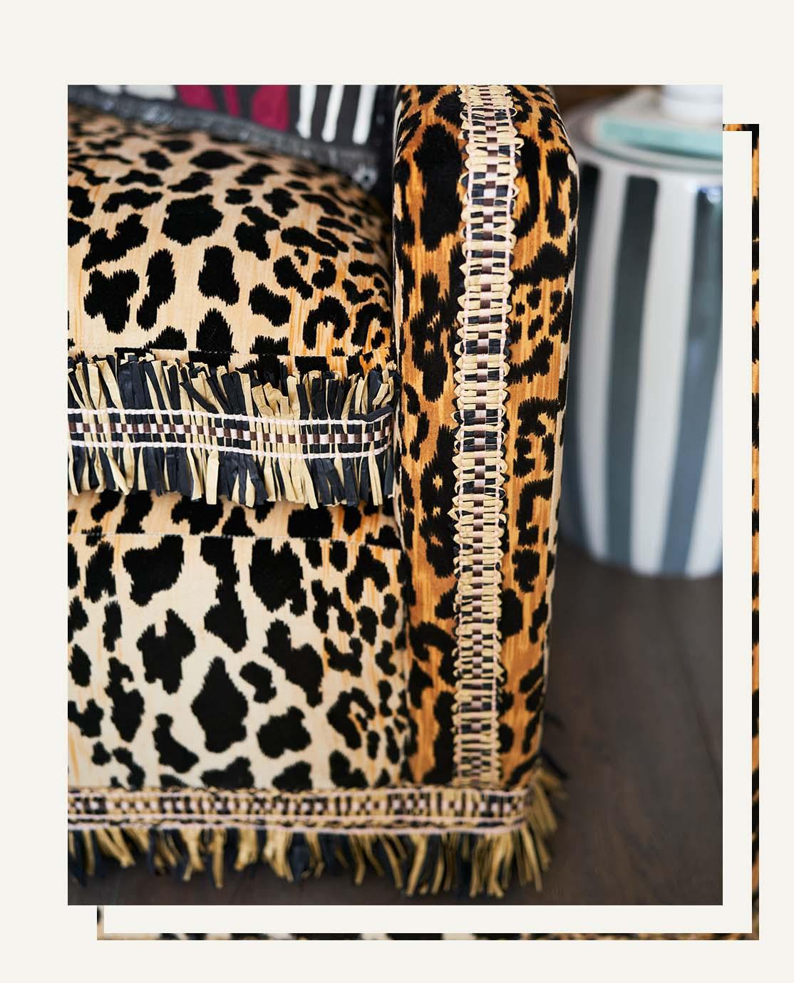 A close-up of ourb bespoke leopard print sofa and rafia trim