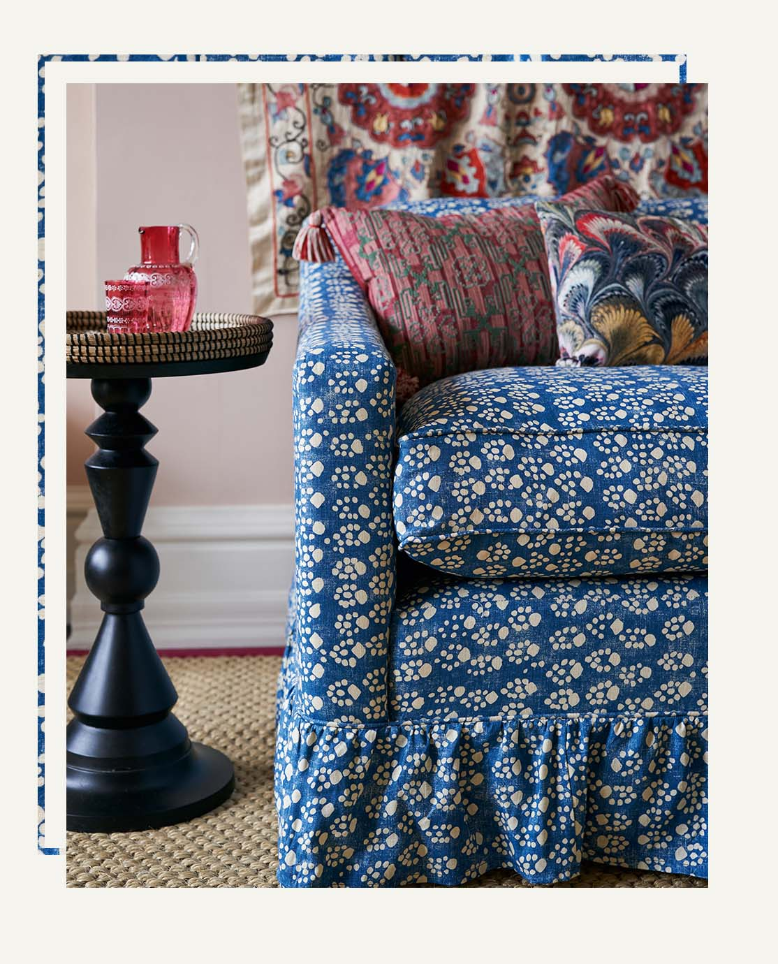 A corner of Jessica Buckley's bespoke sofa, featuring a blue paw-print pattern