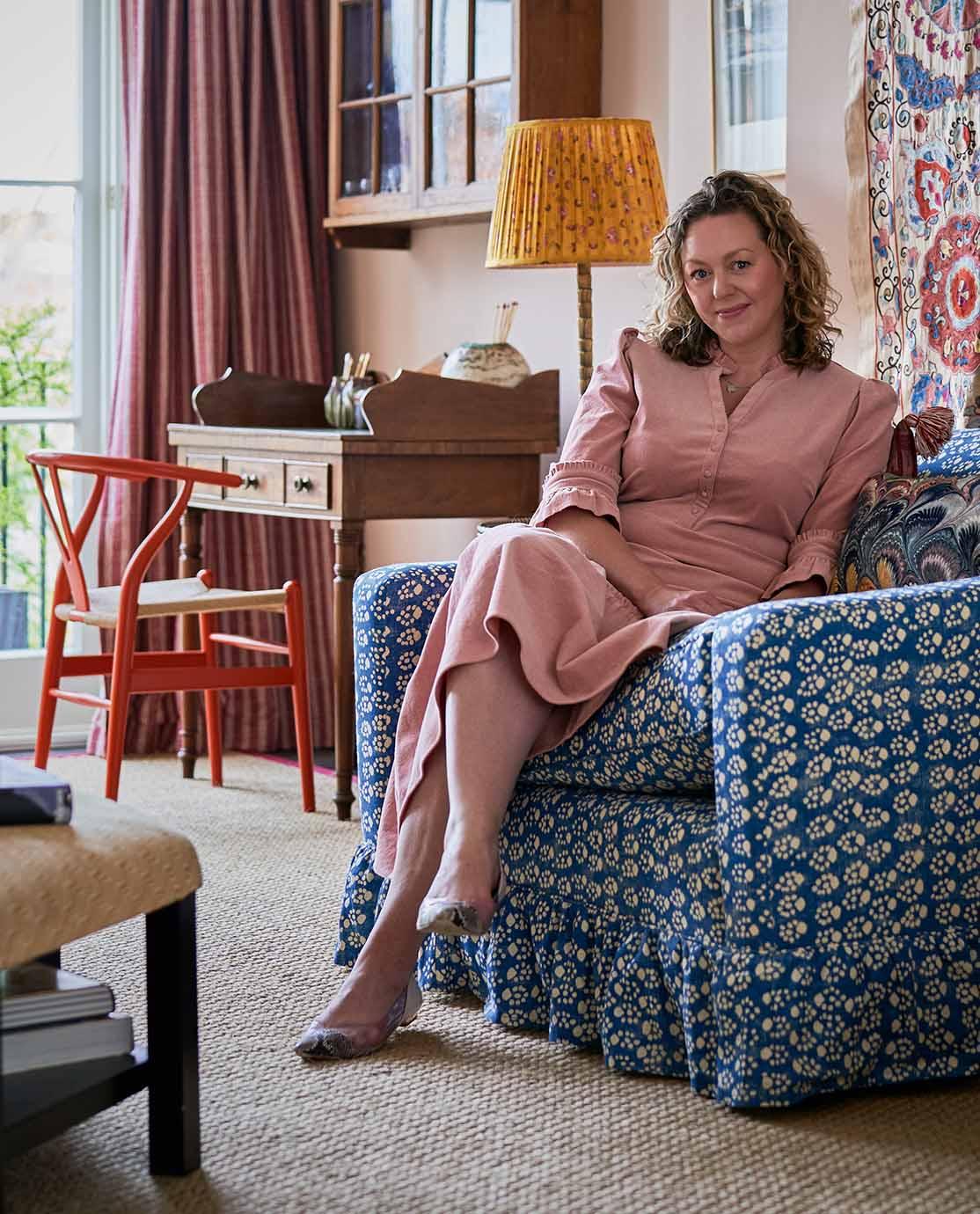Jessica Buckley sat on her bespoke Tailored by OKA sofa