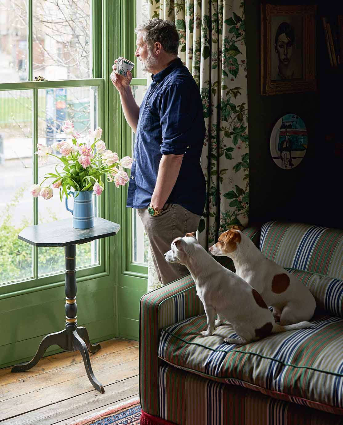Gavin Houghton and his two Jack Russells looking out of a window