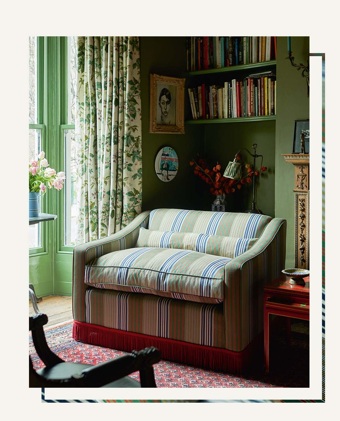 Gavin Houghton's green striped Tailored by OKA sofa in a green sitting room