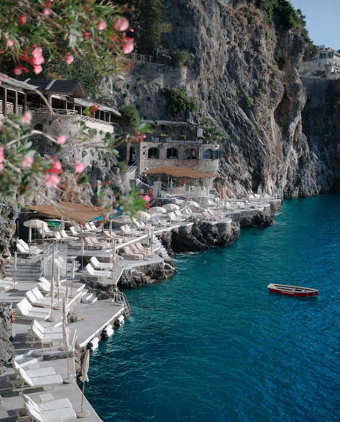White sunloungers overlooking the Amalfi Coast