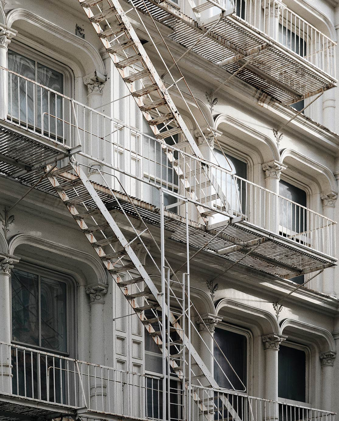 White facade and fire escape stairs in New York