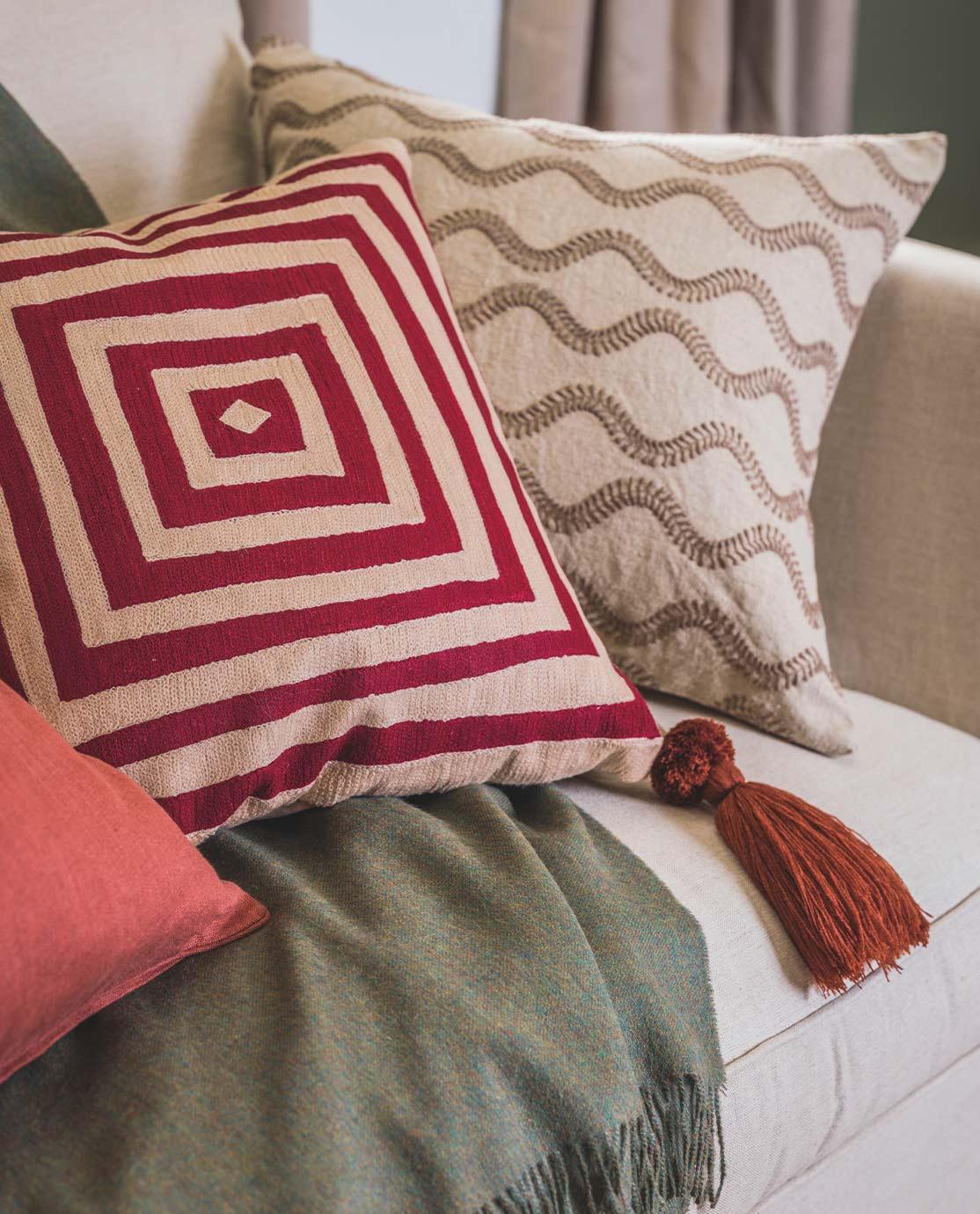 Printed cushions on a white sofa