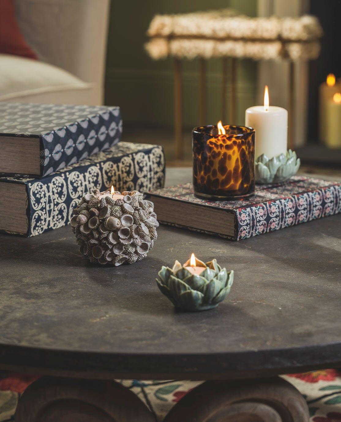 Boxes and candles arranged on a coffee table