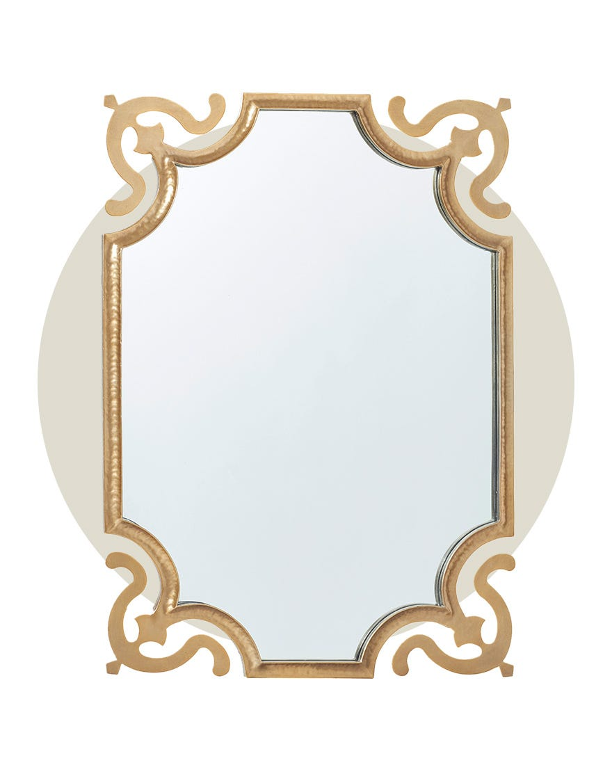 A classic mirror with an intricate gold-painted frame